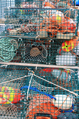 Lobster traps and colorful buoys
