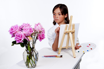 Looking at the flowers to paint.