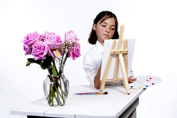 Painting a picture of flowers.