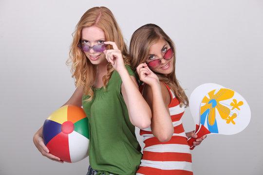Studio shot of teenage girls with beachballs