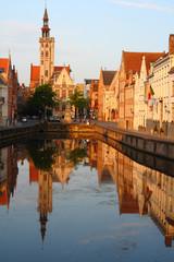 Jan van Eyckplein: old town of Bruges in Belgium at sunset time