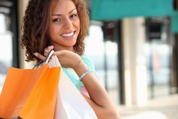 Smiling Metis woman carrying shopping bags