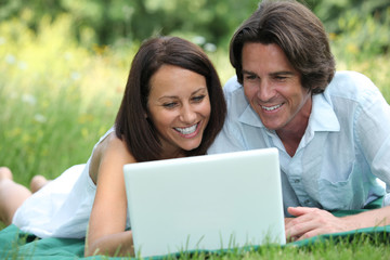 couple in front of a laptop
