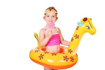 Wall Mural - little girl with ice cream and swimming rubber ready for beach