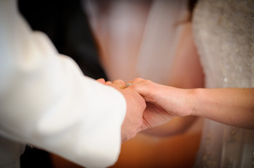 A couple exchange vows at a wedding ceremony
