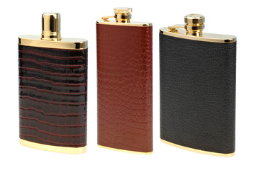 set of leather flasks for alcohol isolated on white