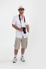 tourist in shorts with camera