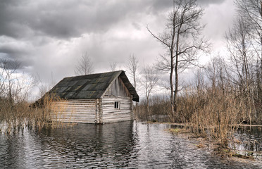 old wooden house in water