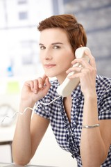 Young woman on landline call