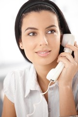 Beautiful woman with landline phone