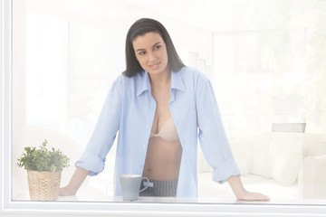 Sexy woman at window
