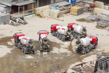 Concrete mixers, tractor and construction materials on big area