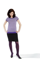 Young woman in violet striped t-shirt and black skirt poses