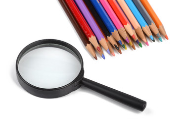 Color pencils and magnifier