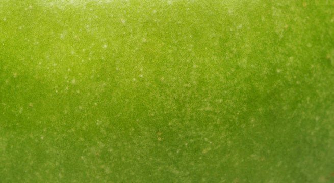 Background a green apple-close up