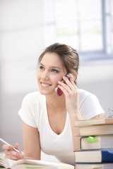 Young woman talking on mobile smiling