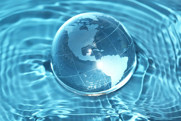 Deurstickers Wereldkaart Glass globe in water