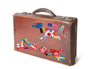 suitcase with wolrd stickers and stamps