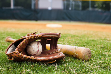 Old Baseball, Glove, and Bat on Field