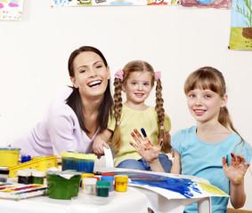 Children painting in preschool.