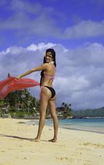 beautiful hispanic woman in bikini at the beach in hawaii