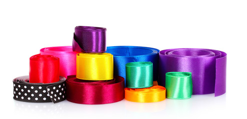 many beautiful bright satin ribbons isolated on white