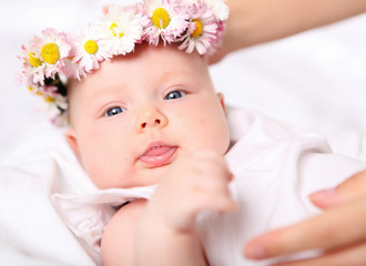 Portrait of a baby with a wreath