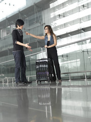 Asian Chinese couple fighting at the airport