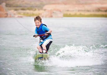 Young Boy learning to Wakeboard Wall mural