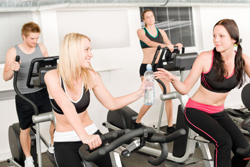 Fitness young girl on gym bike
