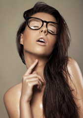 Sexy brunette in a glasses