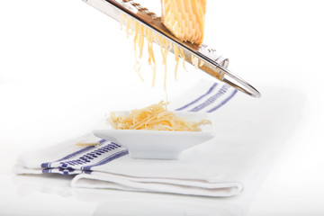 Grating cheese.