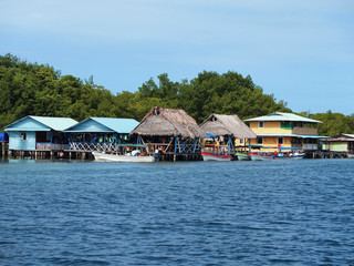 Over the water tropical restaurant with boats at dock, Caribbean sea, Bocas del Toro, Panama, Central America
