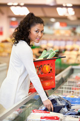 Woman Buying Frozen Food
