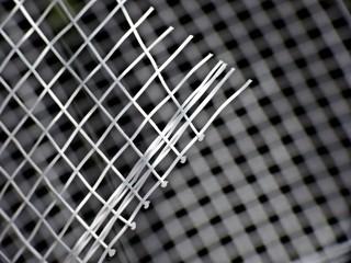 White mesh on black