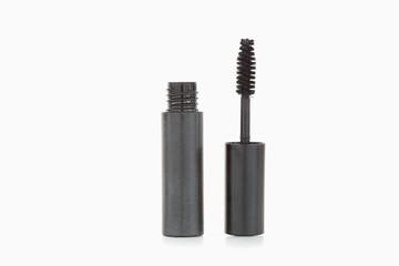 A black mascara brush and tube