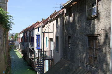 Old houses along a canal in Amiens, France
