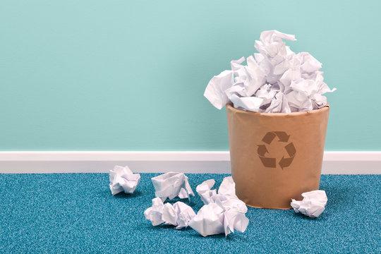 Recycle waste paper basket on office floor