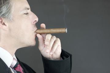 Businessman Smokes Cigar, Side View