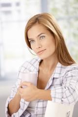 Morning portrait of attractive woman in pyjama