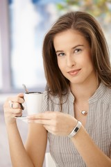 Attractive woman having coffee