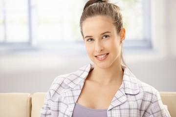 Woman in pyjama on sofa