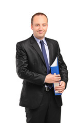 A smiling businessperson holding a folder with documents