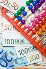 Colorful abacus and european money