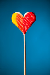candy heart on blue background