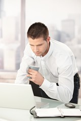 Young businessman busy by working
