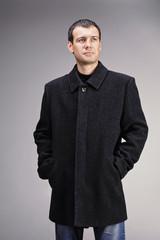 man dressed in black wool coat