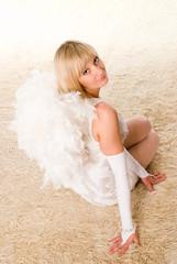 cute angel sitting