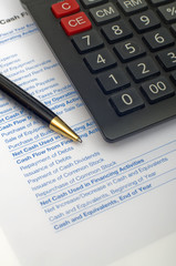 Calculator, Pen and Paperwork