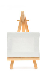Isolated white canvas on easel
